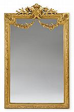 Louis XVI style giltwood mirror, 19th century, The rectangular mirror plate within laurel leaf carved frame, surmounted by cartouche an