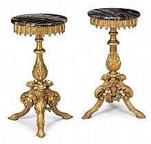 Pair of giltwood and marble top gueridons, late 19th century, The circular portoro marble tops with rounded edges, above a panel and ta