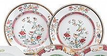 Pair of Chinese export porcelain famille rose plates, mid-18th century, Of circular form, the dished reserves painted with pair of exot