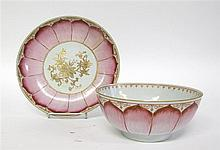 Chinese export porcelain famille rose lotus punch bowl and plate, circa 1770, The circular bowl painted to exterior with three-quarter