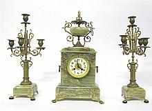 French gilt metal mounted onyx mantel clock garniture, late 19th/early 20th century, The circular dial with Arabic numerals, surmounted