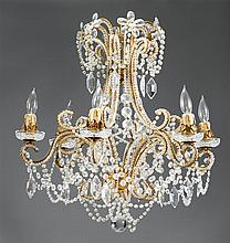 Gilt metal and cut glass six-arm chandelier, 20th century, The scrolling frame with six candlearms joined by a series of faceted glass