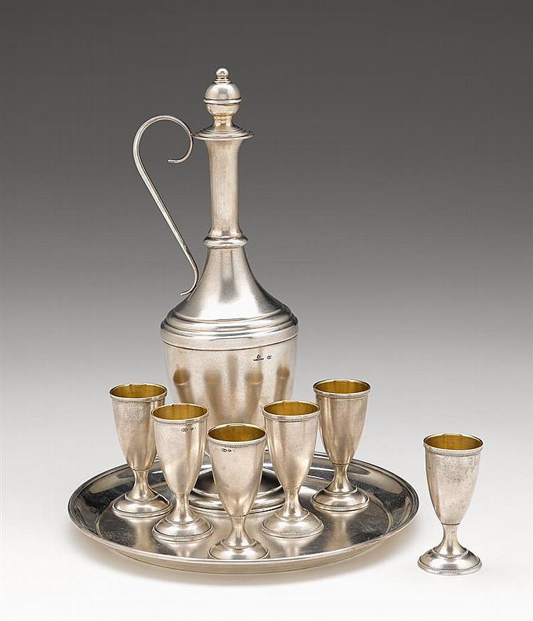 Fine Russian silver vodka set, fabergé, moscow, 1882-99, Matte silver, comprising a decanter with scroll-form handle on stepped circula