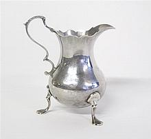 George III silver creamer, i s & a n, london, 1764-65, Baluster form with scalloped rim, scroll-form leaf-capped handle, raised on thre