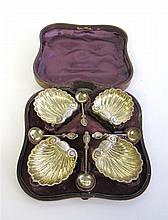 Cased set of four Victorian silver salts and spoons, henry hyde aston, birmingham, 1864-65, Shell-form salts raised on three dolphin fe