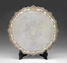 Large George II silver tray, hugh mills, london, 1750-51, Shaped circular form with scroll and shell edge, large engraved armorial with