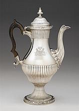 Large George III silver coffee pot, london,1769-70, probably charles wright, Baluster form with fluted lower body, spout, and lid, rais
