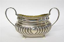 Regency silver twin-handled sugar bowl, solomon hougham, london,1816-17, Oval form with fluted lower body and gadrooned rim, with leaf-