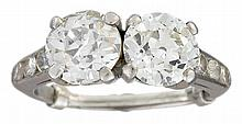 A diamond and platinum 'moi et toi' ring, , set with two old European-cut diamonds, weighing approximately: 1.75 and 1.80 carats resp