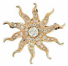 A diamond and fourteen karat gold pendant brooch, , designed as an old mine-cut diamond sunburst; total diamond weight approximately: 0