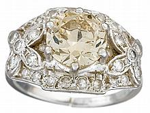 A diamond and platinum ring, , centering a transitional-cut diamond, weighing approximately: 1.95 carats, accented by circular-cut diam