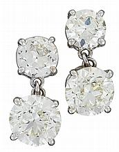 A pair of diamond and fourteen karat white gold earrings, , designed as a drop motif, each set with two old European-cut diamonds, esti