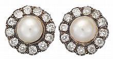 A pair of cultured pearl, diamond and silver-topped eighteen karat gold earrings, 20th century, each set with a round white pearl, meas