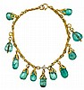 An emerald, diamond and fourteen karat gold bracelet, , comprised of eleven polished emerald drops, detailed links and accented with an