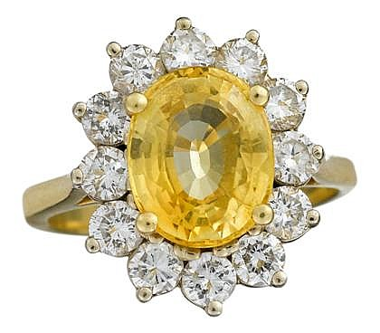 18 karat yellow gold, yellow sapphire and diamond ring, Clyde Duneier, , Oval cut yellow sapphire, approximately 3.48 carats, surrounde