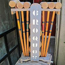 Art Deco croquet set, circa 1930, The painted pine carrier with the full compliment of six mallets, six balls, and eight wickets.