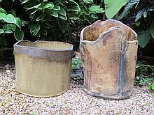 Two studio slab-built stoneware vessels, late 20th century, The taller wood-fired with undulating rin over seamed body, the other of ci