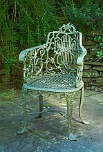 Robert Wood cast iron garden chair, philadlephia, mid 19th century, Barrel-form with lyre-form and foliate scroll-cast back under rose