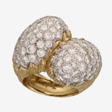 A diamond, platinum and eighteen karat gold ring, Hammerman Bros.