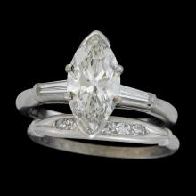 A diamond and platinum ring with band