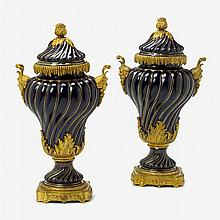 Pair of French gilt bronze mounted Sèvres style porcelain covered urns, 20th century
