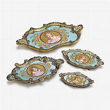 Four French Art Nouveau porcelain and champlevé enamel trays, late 19th century
