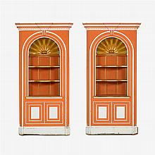 Pair of Regency style orange painted, parcel gilt and plaster inset pine corner cupboards, early 20th century