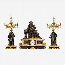 Large and impressive Napoleon III patinated bronze and polished slate clock garniture, 19th century