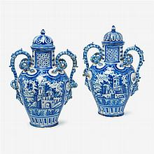 Pair of Delft style twin handled covered urns,