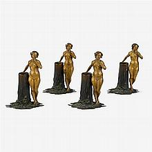 Four Austrian cold-painted bronze candlesticks, early 20th century