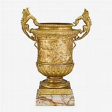 Fine French gilt bronze twin handled urn, after the model by Claude Ballin, third quarter 19th century