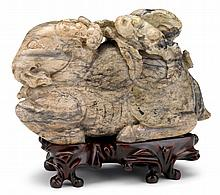 Chinese calcified jade 'ram' carving, , Recumbant ram grasping a lingzhi spray in its mouth; stone of mottled grey and ivory tone.