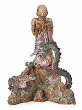 Chinese porcelain figure of emaciated luohan and serpent, , The figure standing scantily clad in finely enameled famile rose garments o