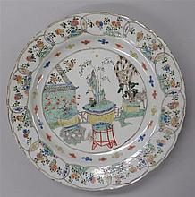Large Chinese wucai barbed rim charger, kangxi period, Center medallion enameled with rockwork and bonzai plants against a garden setti