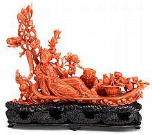 Chinese carved coral figural grouping, late 19th century, Detailed carving of a seated beauty flanked by boy and framed by peach grove