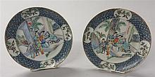 Pair of Chinese famille rose porcelain plates, 18th / 19th century, Each similarly decorated to show five courtly figures in a palace i