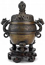Chinese tripod bronze censer and cover, qing dynasty, The censer with double dragon handles and tripod beast head claw feet, incised to