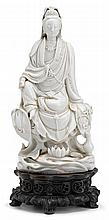 Chinese blanc-de-Chine 'dehua' figure of seated Guanyin, 17th century, Seated in royal ease, elevated on perforated rockwork, the lon