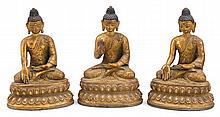 Set of three Tibetan bronze buddhas, 19th century, Each figure with hands in one of three mudras abhaya, bhumisparsa, and varada. All a
