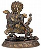 Sino-tibetan bronze figure of Mahakala, qing dynasty, The ferocious diety clutching a vajra and a ball as attributes, standing atop a c