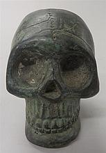 Bronze skull, , Cast and incised to realistically represent a skull, possibly Cambodian.