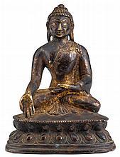 A Sino-Tibetan gilt bronze Buddha, qing dynasty, The figure seated in dhayanasana with hands in varada mudra, dressed in a sheer sangha