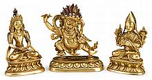 Three Tibetan gilt bronze figures, , Consisting of Vajrapani modelled striding in alidhasana on a lotus base, his left hand is in vitar