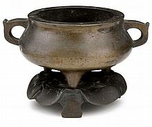 Chinese tripod bronze censer on cast base stand, 17th / 18th century, Twin handle and compressed body slightly everting at mouthrim, tw