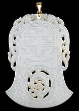 Chinese white jade axe-form pendant, , Archaic style bell-shaped pendant open worked with qilong dragons, keyfret bands and taotie mask