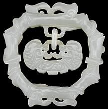 Chinese celadon jade pendant, , Carved in round as a lock hanging from a circular bamboo wreath