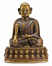 Tibetan applied silver cast bronze Buddha, qing dynasty, Seated in dhyanasana with his hands in bhumisparsa and dhyana mudra, the robes