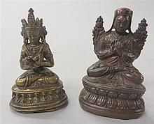 Two Tibetan miniature bronze buddhist figures, , Including a seated lama, bronze of red hue, and a seated bodhisattva hands crossed at