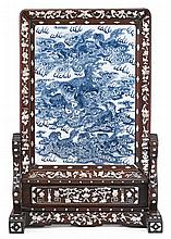 Pair of Chinese blue and white porcelain plaques, qing dynasty, Both plaques of the same size; one depicting a scene of dragons passing