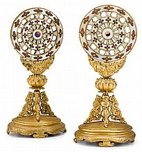 Impressive pair of Sino-Tibetan gilt metal and mother-of-pearl Buddhist wheels of law, 19th century, Circular wheel, applied over lotus